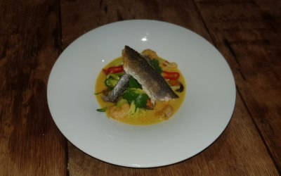 Pan Fried Fillet of Sea Bass on Vegetable Noodles in a Curried Coconut Broth